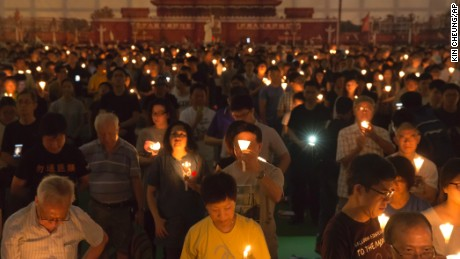 Tens of thousands of people attend an annual candlelight vigil at Hong Kong's Victoria Park, Sunday, June 4, 2017.