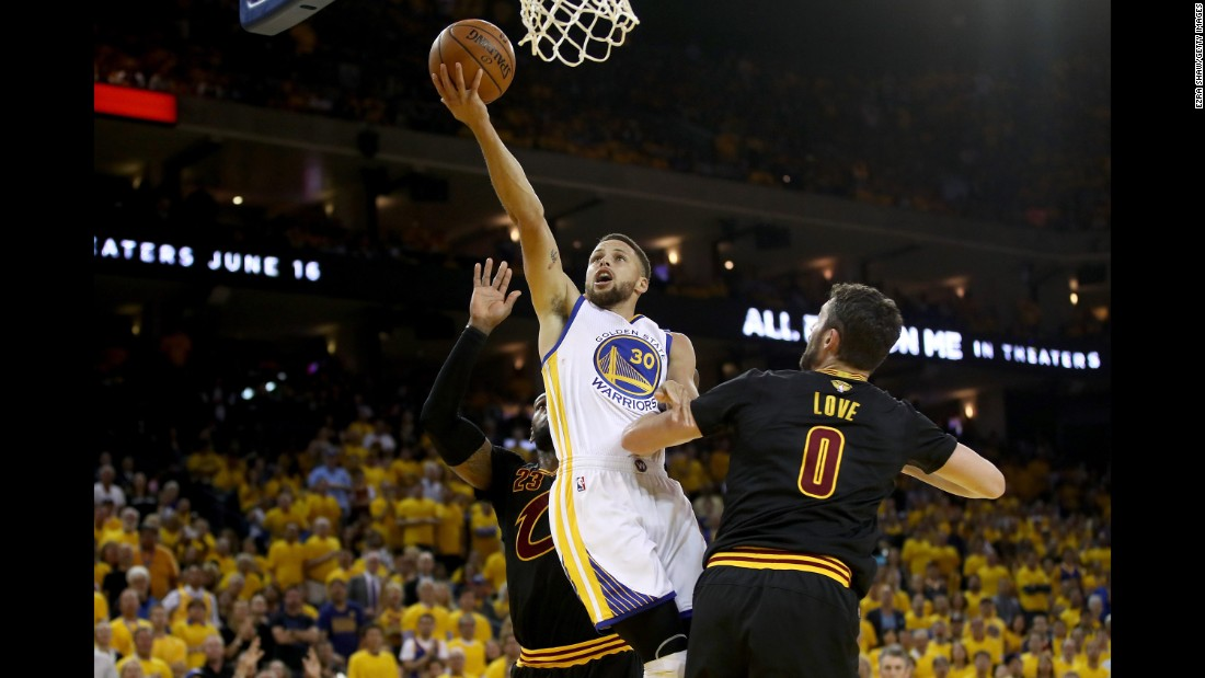 Curry goes up for a layup in Game 2. He also had a triple-double: 32 points, 11 assists and 10 rebounds.