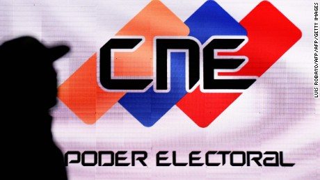 "A screen with the logo of the National Electoral Council (CNE) in the media room at the CNE headquarters in Caracas,  on December 5, 2015. For the first time in 16 years of ""Bolivarian revolution"" under late president Hugo Chavez and his successor Nicolas Maduro, polls show their rivals could now win a majority in the National Assembly.  AFP PHOTO / LUIS ROBAYO / AFP / LUIS ROBAYO        (Photo credit should read LUIS ROBAYO/AFP/Getty Images)"