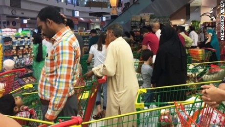 People are seen buying essential food staples at a supermarket in Doha, Qatar, Monday, June 5, 2017.