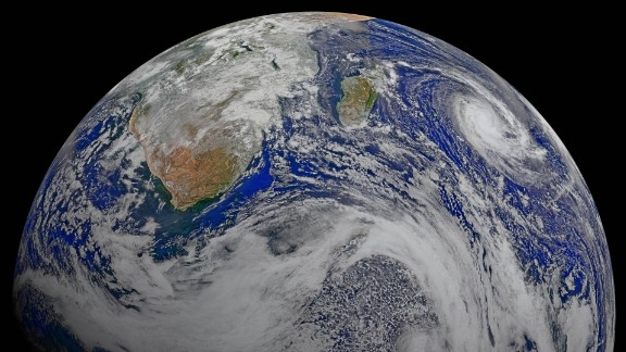 Satellite: Suomi-NPP Sensor: VIIRS Date: 9 April 2015 Description:  Data from six orbits of the Suomi-NPP spacecraft have been assembled  into this perspective composite of southern Africa and the surrounding oceans.  Tropical Cyclone Joalane is seen over the Indian Ocean. Data used:   The image was constructed from six orbits of surface reflectance (rhos)   data using the 671, 551, and 443 nm bands for red, green, and blue   respectively. Projection:  near-sided perspective projection from 8300 kilometers above 50 South by 40 East Projection details:  mapproject -Rd -JG40/-50/2.3/0/0/0/60/60/150 Image created by: Norman Kuring