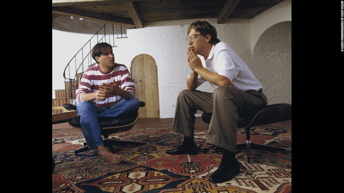 "During a 1991 portrait session, a barefoot <a href=""http://www.cnn.com/2013/08/23/us/steve-jobs-fast-facts/index.html"">Steve Jobs</a> sits opposite his more businesslike Microsoft counterpart, <a href=""http://www.cnn.com/2013/05/07/us/bill-gates-fast-facts/index.html"">Bill Gates.</a> The '90s were a pivotal time for Jobs, in particular. After leaving the company he founded in the mid-'80s, he returned to his post as Apple CEO in 1997 and reinvigorated the company with the release of innovative new products."
