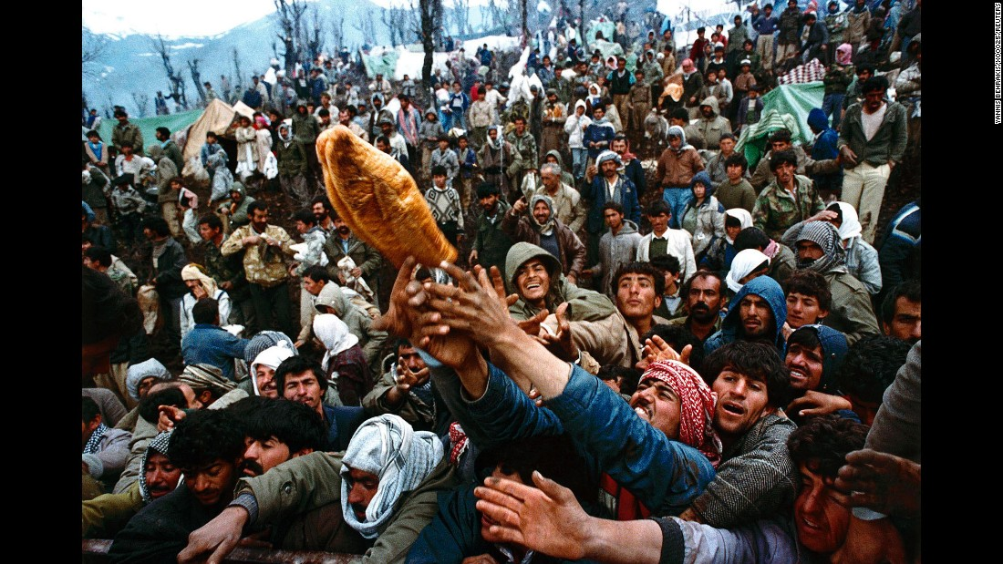 Though the Gulf War came to an end in 1991, internal conflict continued to roil Iraq in the years after and for much of the 25-plus years since. In this April 5, 1992 photo, frantic Kurdish refugees, forced to flee Saddam Hussein's regime, jostle for a loaf of bread during an aid distribution near the Iraqi-Turkish border.