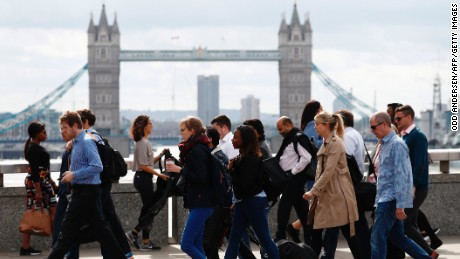 Commuters walk across London Bridge on Monday after it partially reopened.