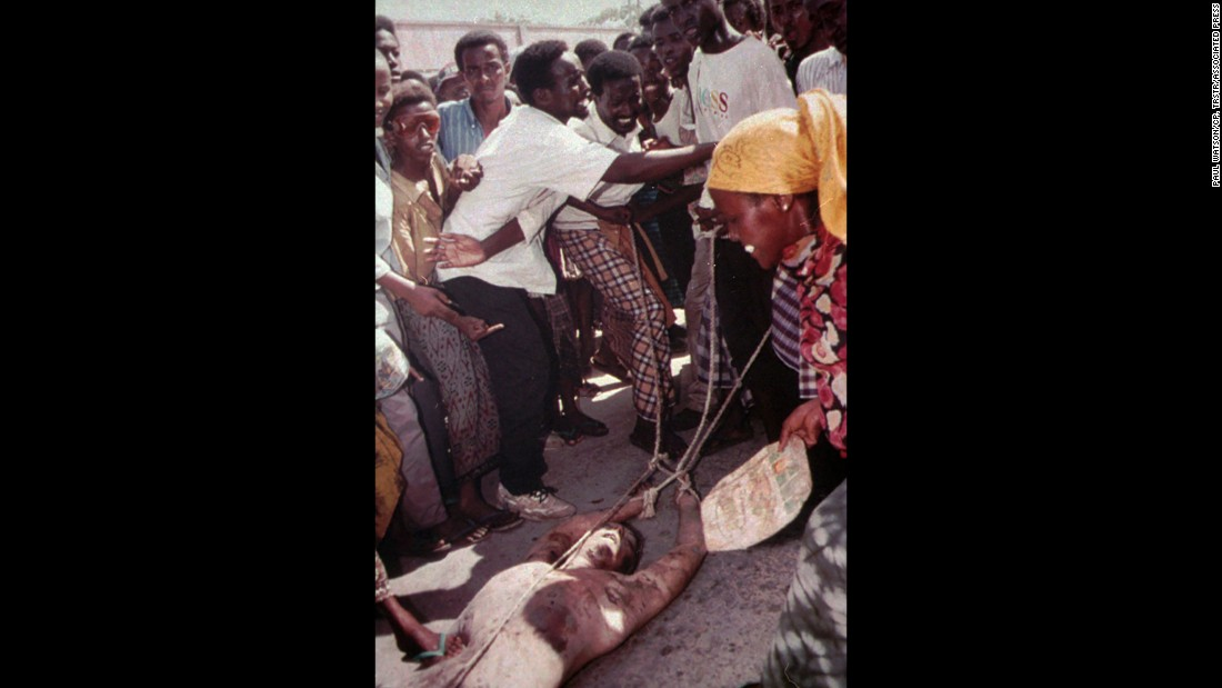 The body of a dead US soldier is dragged through the streets of Mogadishu, Somalia, on October 4, 1993. He was one of 18 Americans killed in a failed raid in the city. The assault was aimed at capturing a notorious Somali warlord, but US forces were met with heavily armed resistance. Two US Black Hawk helicopters were downed in the operation, which also killed hundreds of Somalis.
