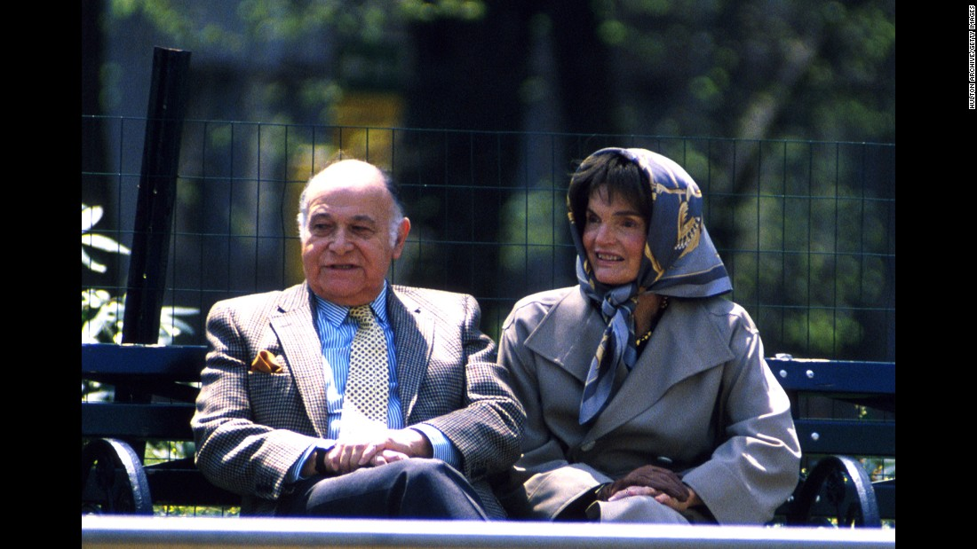 Jacqueline Kennedy Onassis is seen on April 4, 1994, in New York's Central Park with her companion, Maurice Tempelsman. The former first lady was known for her style, her love of the arts, and the low profile she kept in the wake of the assassination of her first husband, President John F. Kennedy. Just over a month after this photo was taken, the beloved former first lady died of cancer at age 64.<br />