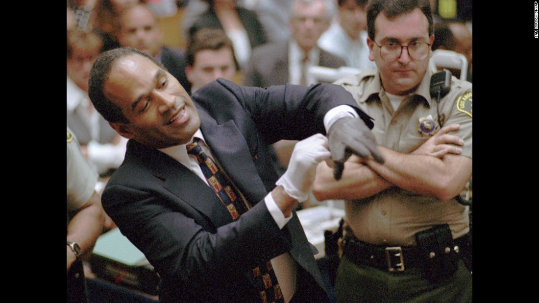 "In one of the most memorable moments of a blockbuster murder trial, on June 15, 1995, <a href=""http://www.cnn.com/2013/04/12/us/o-j-simpson-fast-facts/index.html"">O.J. Simpson</a> struggled to fit his hand into a glove prosecutors claimed he wore the night his ex-wife Nicole Brown Simpson and Ronald Goldman were killed. The prosecution's request to have Simpson try the gloves on in court was a pivotal moment in the trial, which ended with the former NFL star's acquittal. <em>Want more? Listen to </em><em><a href=""http://podcasts.cnn.net/embed/single/skin/07h8n0/the-trial-of-a-century.html"" target=""_blank"">""The Trial of a Century""</em></a><em> on CNN's <em></em><a href=""https://itunes.apple.com/us/podcast/id1252458994"" target=""_blank"">""The Rewind: 90s Edition""</em></a><em> podcast.</em><br />"