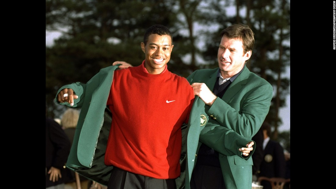 "Over four days in Augusta, Georgia, in April 1997, golf's next great champion announced his arrival in record-breaking fashion. At age 21 and 3 months, <a href=""http://www.cnn.com/2013/05/30/us/tiger-woods-fast-facts/index.html"">Tiger Woods </a>became the youngest player to win the Masters, after posting a record-low score of 18-under par. Here, 1996 Masters champion Nick Faldo helps Woods into his new green jacket."