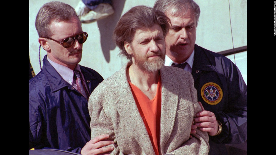 "Shown on April 4, 1996, the day after his arrest, <a href=""http://www.cnn.com/2013/08/14/justice/gallery/crimes-of-the-century-unabomber/index.html"">the Unabomber</a>, Ted Kaczynski, is led by FBI agents out of a Montana federal courthouse. Starting in 1978, Kaczynski had carried out a series of deadly bombings that killed three people and injured 24, while he managed to elude authorities. After The New York Times and The Washington Post published the Unabomber's 35,000 word manifesto, a tip from Kaczynski's brother led investigators to his remote Montana hideout."