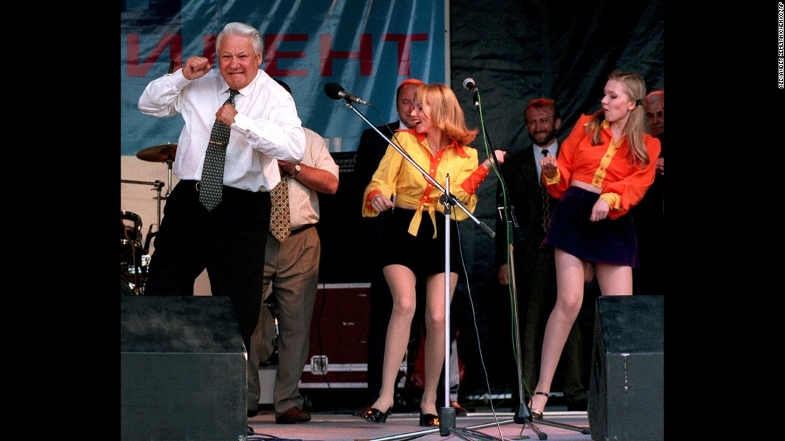 At a rock concert, Russian President Boris Yeltsin, who became the country's first popularly elected leader in 1991, boogies with band members during his campaign for re-election on June 10, 1996. Despite suffering multiple heart attacks in the lead-up to the '96 election, Yeltsin won. He resigned three years later, paving the way for Vladimir Putin's rise to power.