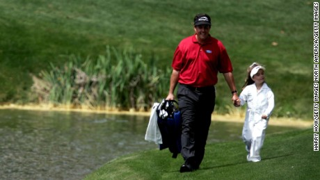 Mickelson walks with Amanda, during the Par-3 contest at The Masters in 2005.