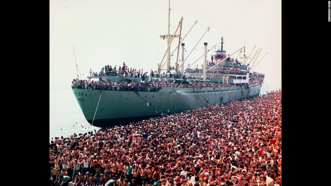 After decades under a Communist regime, Albania pivoted toward democracy under then-President Ramiz Alia. But the transition did not go smoothly, and Alia's government made a swift descent toward anarchy in 1991. Here, thousands of desperate Albanian refugees are shown packed into the harbor of Brindisi in southern Italy, fleeing the chaos at home.