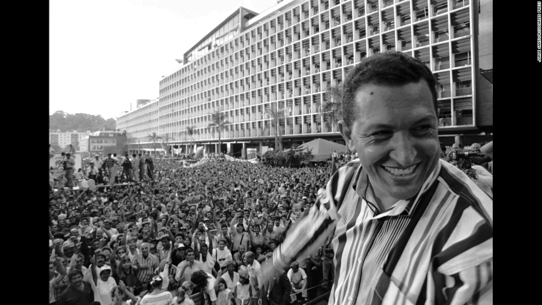 "<a href=""http://www.cnn.com/2012/12/11/world/americas/hugo-chavez---fast-facts/index.html"">Hugo Chavez</a> is shown speaking to crowds gathered in Caracas, Venezuela, on February 4, 1998, during an anniversary celebration of his attempted 1992 coup. Though his first attempt to assume the presidency was unsuccessful, Chavez became president in 1999, and shortly after revamped the constitution to claim even more power."