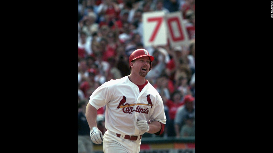 "In 1998, baseball fans were treated to a home run race unlike anything the sport had seen, with St. Louis Cardinals slugger Mark McGwire and Chicago Cubs star Sammy Sosa trading long balls all season as they chased Roger Maris' single-season record of 61 home runs. McGwire is shown after belting his 70th and final home run of the 1998 campaign. But his record was broken three seasons later by Barry Bonds, and like many others who played in the so-called ""steroid era,"" McGwire later admitted to using performance-enhancing drugs during the 1998 season."