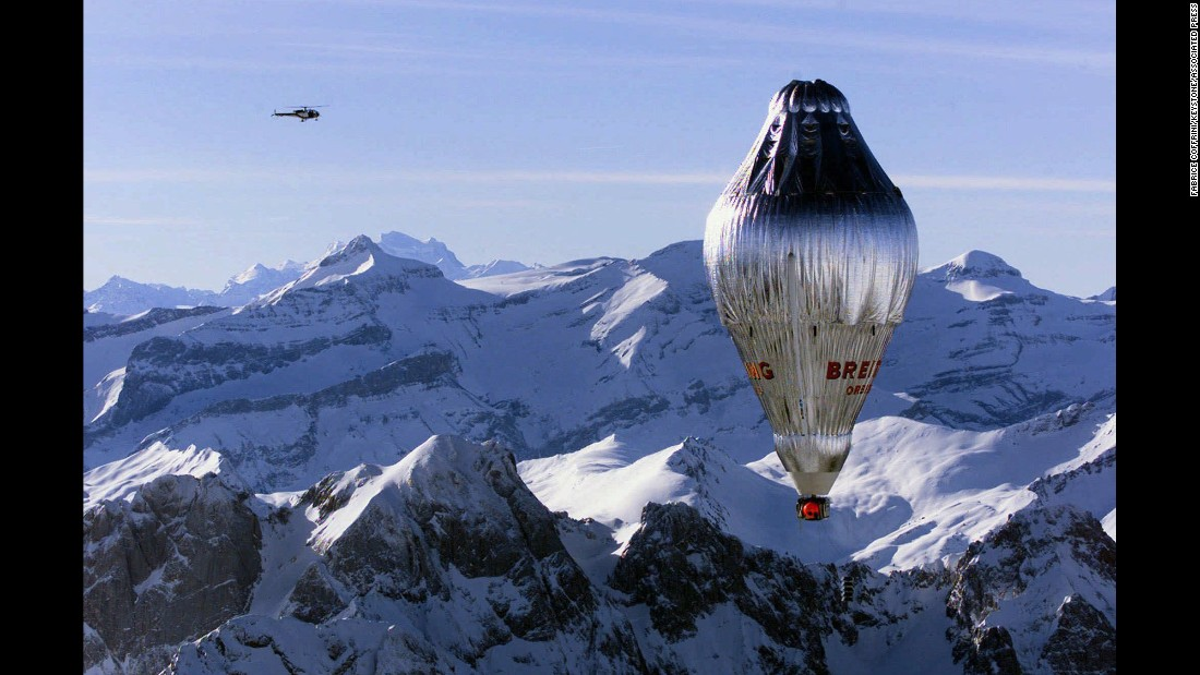 "Piloted by Switzerland's Bertrand Piccard and his English co-pilot, Brian Jones, the Breitling Orbiter 3 balloon is shown sailing over the Swiss Alps on March 1, 1999. Just 20 days later, Piccard and Jones achieved the first nonstop balloon trip around the world when they landed safely in North Africa. After landing, <a href=""http://www.nytimes.com/1999/03/21/world/balloon-history-and-in-only-20-days.html"" target=""_blank"">Jones was asked how he'd celebrate his achievement and told The New York Times</a>, ""The first thing I'll do is phone my wife, and then, like the good Englishman I am, I'll have a cup of tea.''"