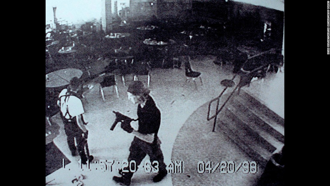 "Surveillance tape from Columbine High School on April 20, 1999, shows Eric Harris, left, and Dylan Klebold carrying guns through the school's cafeteria. The two students carried out <a href=""http://www.cnn.com/2013/09/18/us/columbine-high-school-shootings-fast-facts/index.html"">one of the deadliest school shootings in US history</a>, killing 12 students and one teacher, before turning the guns on themselves in the school's library."