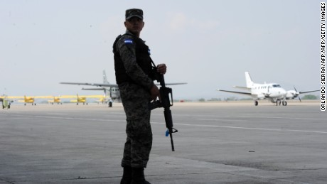 A soldier keeps watch by airplanes idle on the ramp of the Enrique Soto Cano military base in Palmerola, 80 km north of Tegucigalpa, on March 31, 2016. In site of the base, that currently hosts Honduran military aircrafts and the U.S. Joint Task Force Bravo, it will be built the Palmerola international airport with a 2,440-metre-long  (8,000 feet) runway at a cost of USD 163 million. AFP PHOTO/Orlando SIERRA / AFP / ORLANDO SIERRA        (Photo credit should read ORLANDO SIERRA/AFP/Getty Images)