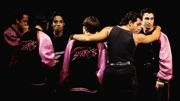 "Puerto Rican identity has played a prominent role in popular culture and entertainment. Hip-hop and breakdancing grew out of a multicultural New York landscape that included African-American and Puerto Rican youths. Here, a production of ""West Side Story"" features the fleet-footed Puerto Rican Sharks gang."