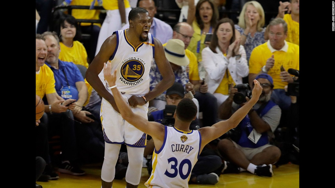 "Golden State's Kevin Durant and Stephen Curry celebrate during Game 2 of the <a href=""http://www.cnn.com/2017/06/02/sport/gallery/nba-finals/index.html"" target=""_blank"">NBA Finals</a> on Sunday, June 4. Golden State defeated Cleveland 132-113 to take a 2-0 lead in the best-of-seven series. The Warriors are a perfect 14-0 during this year's playoffs."
