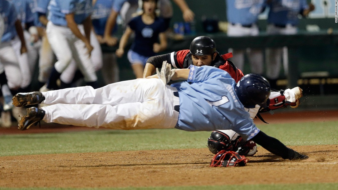 Davidson catcher Jake Sidwell tags out North Carolina's Brandon Riley during a college baseball game in Chapel Hill, North Carolina, on Sunday, June 4. Davidson won 2-1 to advance to the NCAA Super Regionals.