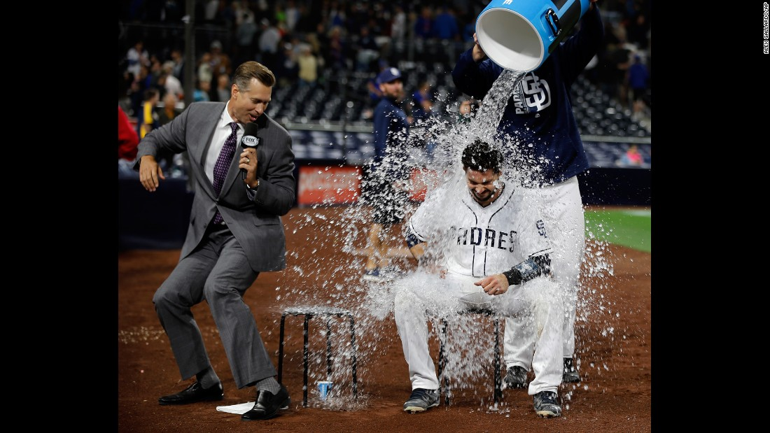 San Diego's Austin Hedges gets drenched by teammate Ryan Buchter during a postgame interview on Tuesday, May 30. Hedges had 4 RBIs in a 6-2 victory over the Chicago Cubs.