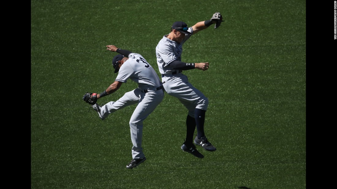 New York Yankees Aaron Hicks, left, and Aaron Judge celebrate a win in Toronto on Saturday, June 3.