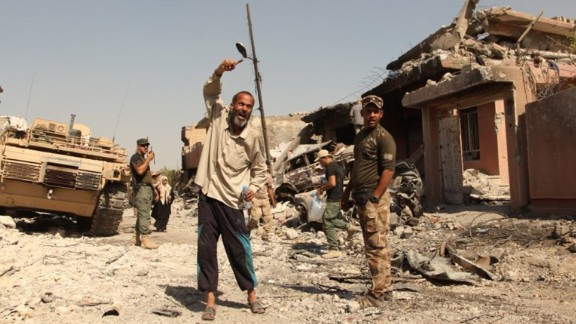An Iraqi man shouts that ISIS killed his son when he tried to escape from the Zinjili neighborhood in western Mosul to a government-controlled area. ISIS took control of Mosul -- the largest city in Iraq -- in June 2014. The operation to liberate it started in October 2016 -- and is still ongoing.