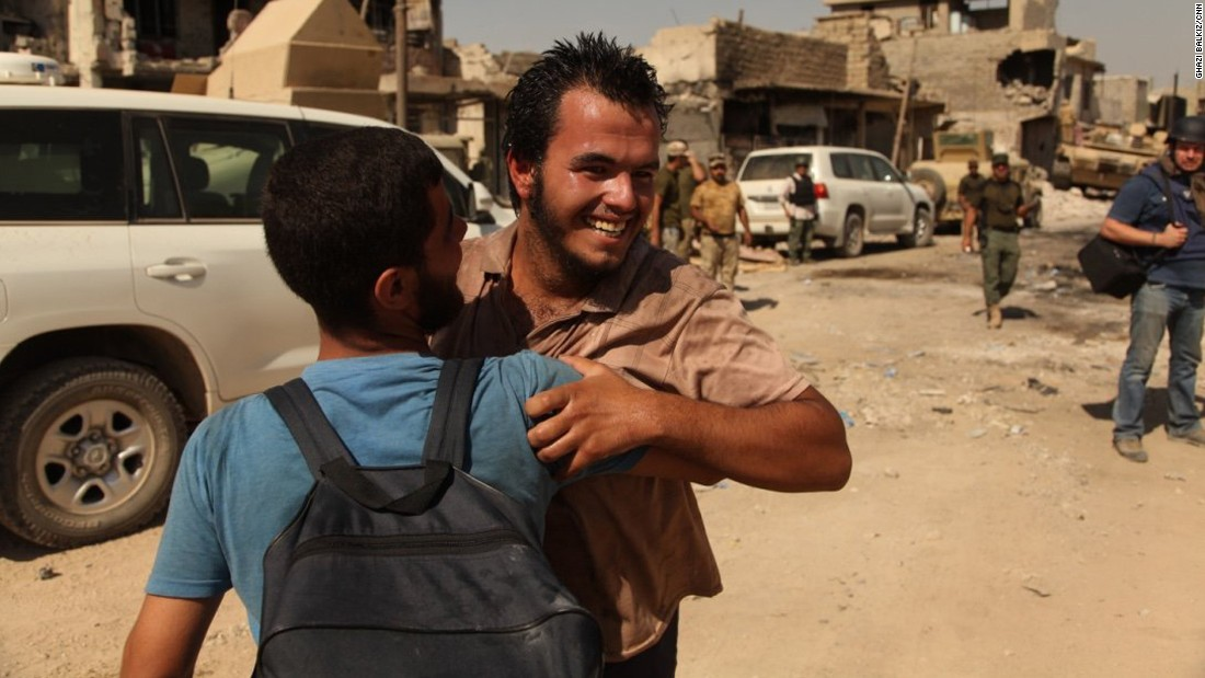 Salim Sa'ed smiles and hugs his neighbor after they both were able to escape the Zinjili neighborhood, one of the very few districts still under ISIS control in western Mosul, on June, 4, 2017.