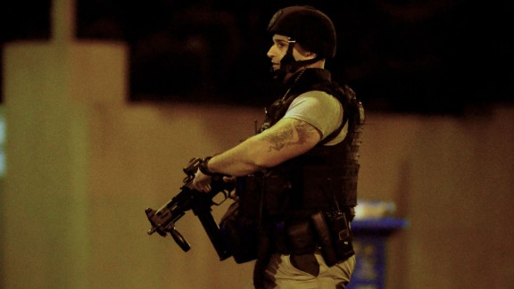 An armed police officer walks at the scene of the attack on June 5, in the Melbourne suburb of Brighton.