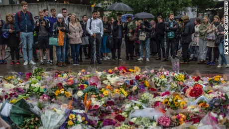 LONDON, ENGLAND - JUNE 05:  Members of the public gather near flowers on the South side of London Bridge, close to Borough Market in London in tribute to the victims of the June 3 attacks, on June 5, 2017 in London, England. British police on Monday made several arrests in two dawn raids following the June 3 London attacks, claimed by the Islamic State group which left seven people dead.  (Photo by Dan Kitwood/Getty Images)