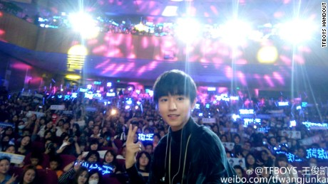 Wang Junkai, lead singer of Chinese boy band TFboys, surrounded by fans during his birthday celebration.