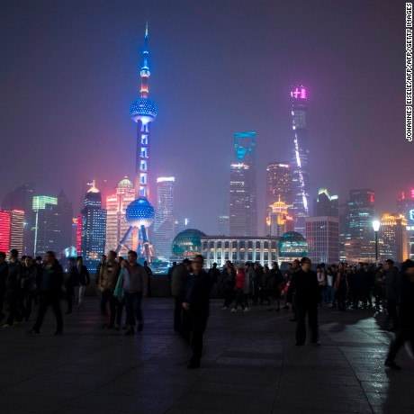 The skyline of the Lujiazui Financial District in Pudong, Shanghai is seen moments before its lights turned off for the Earth Hour environmental campaign on March 25, 2017. / AFP PHOTO / Johannes EISELE        (Photo credit should read JOHANNES EISELE/AFP/Getty Images)