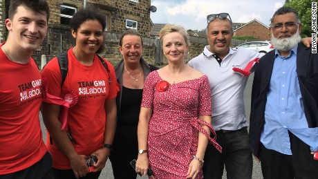 Tracy Brabin (center, in red dress) with part of her team on the campaign trail. After less than a year as an MP in Westminster, Brabin is fighting for re-election.