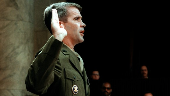 WASHINGTON, :  Lieutenant-Colonel Oliver North, former aide to former National Security Adviser John Poindexter, is sworn in 07 July 1987 before the House and Senate Foreign Affairs Committee hearing in Washington, D.C. on arms sales to Iran and diversion of profits to Nicaraguan Contra rebels.