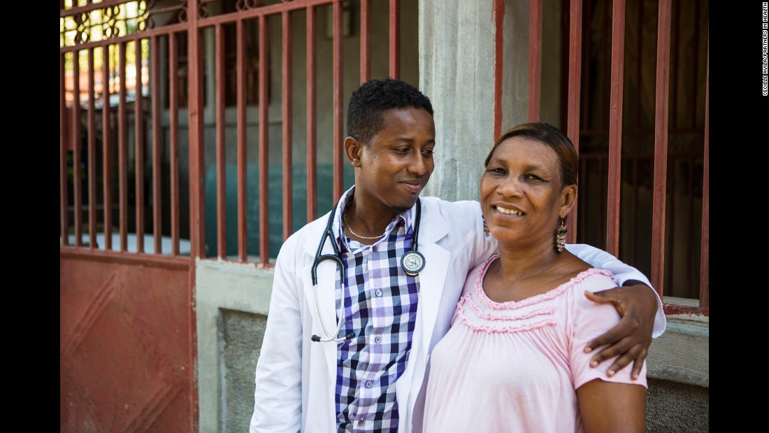 "Sauvener shares a moment with his mother, Alourdes Gracia. Their decades-long connection with Farmer and the hospital is a reminder of how their lives have come full circle -- as ""Baby"" and his colleagues use their skills to help the community."