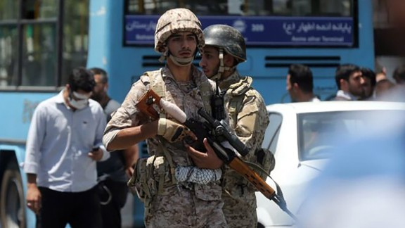 Iranian soldiers stand guard near parliament during the attack Wednesday.