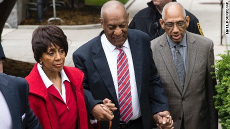 Who shows up with Bill Cosby to court?