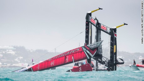 TOPSHOT - Emirates Team New Zealand skippered by Peter Burling is seen capsizing at the race start in race 5 of the 35th America's Cup Challenger Playoffs Semi-finals on June 6, 2017 in Bermuda's Great Sound. / AFP PHOTO / Mark Lloyd        (Photo credit should read MARK LLOYD/AFP/Getty Images)