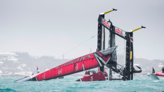 TOPSHOT - Emirates Team New Zealand skippered by Peter Burling is seen capsizing at the race start in race 5 of the 35th America