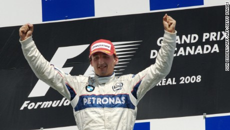 Robert Kubica celebrates on the podium in Montreal after winning the 2008 Canadian Grand Prix.