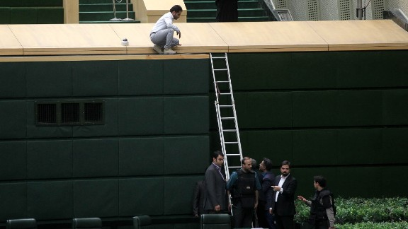 Iranian security personnel deploy inside the parliament building Wednesday to protect lawmakers during the attack.