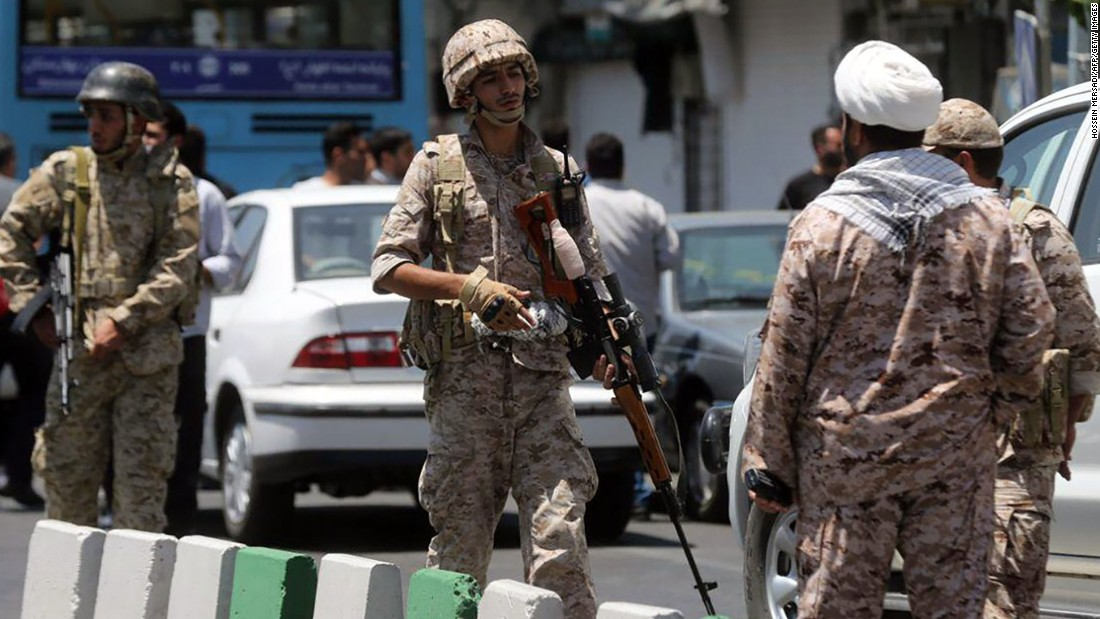 Members of Iran's Revolutionary Guard secure the area outside the parliament complex in Tehran during an attack Wednesday.