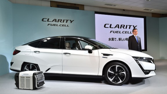 Honda Motors President Takahiro Hachigo poses with its new fuel cell vehicle (FCV), the Clarity Fuel Cell during a press preview at the company's headquarters in Tokyo on March 10, 2016.  Honda Motor announced on March 10 that they will began sales in Japan of its all-new Clarity Fuel Cell. / AFP / KAZUHIRO NOGI        (Photo credit should read KAZUHIRO NOGI/AFP/Getty Images)