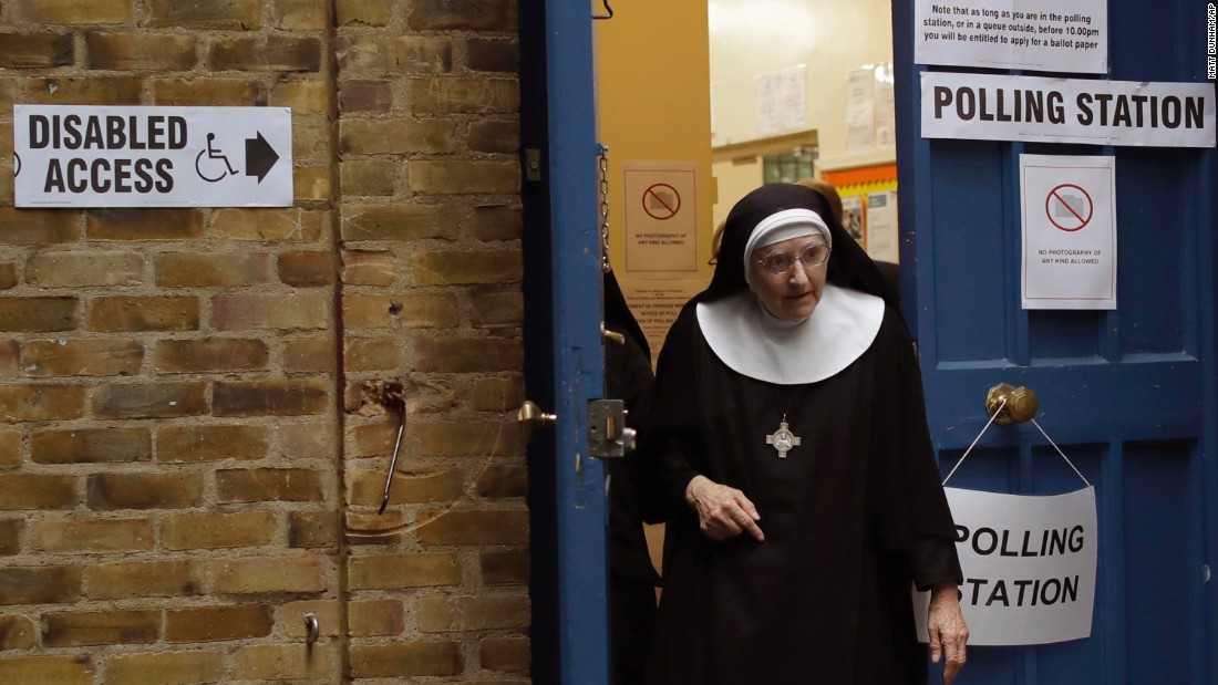 A Benedictine nun leaves a polling station after voting in London.