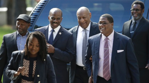 Bill Cosby, arrives with supporters, from left, Joe Torry and Lewis Dix, for his sexual assault trial at the Montgomery County Courthouse in Norristown, Pennsylvania Thursday, June 8, 2017.
