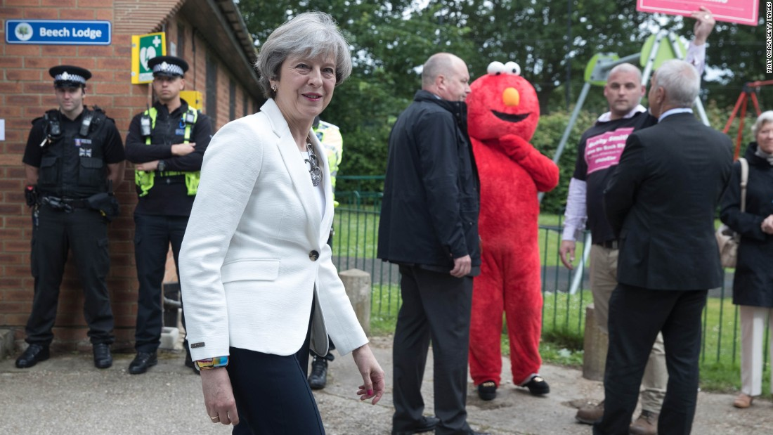 Prime Minister May leaves a polling station in Sonning, England.