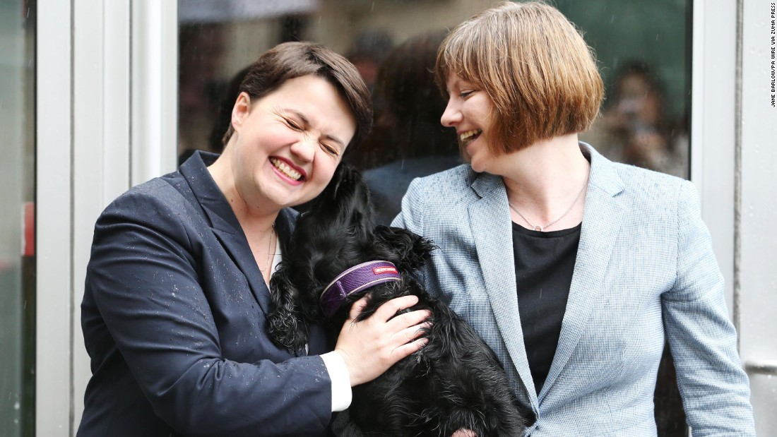 Scottish Conservative leader Ruth Davidson, left, arrives with her partner, Jen Wilson, to cast her vote in Edinburgh, Scotland.