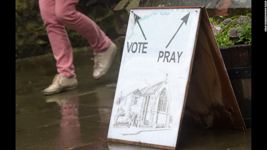 A sign directs voters at a polling station at St. James Church in Edinburgh.
