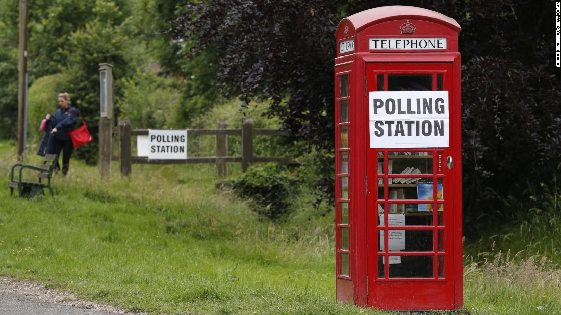A sign is seen on a telephone box outside a polling station at Rotherwick Hall, west of London.