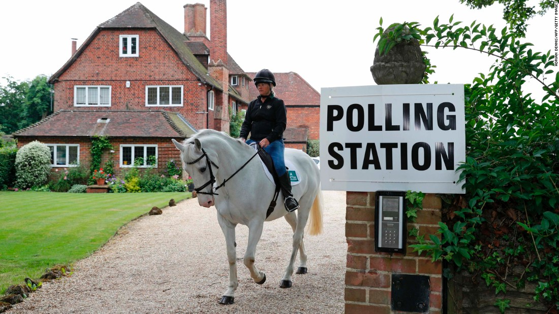 Sophie Allison rides her horse out of a polling station set up at a private residence near Reading, England.